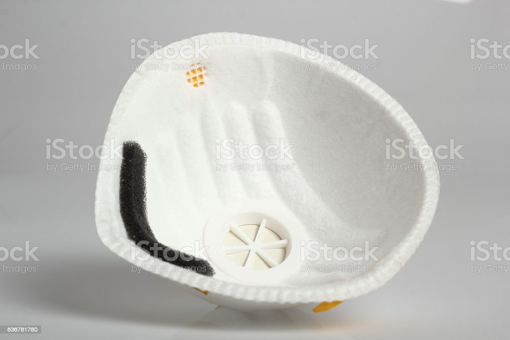 Valved Respirator. Disposable Dust Face Mask. stock photo