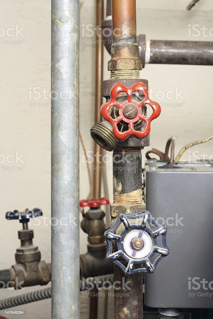Valves and pipes - components of a heating system royalty-free stock photo