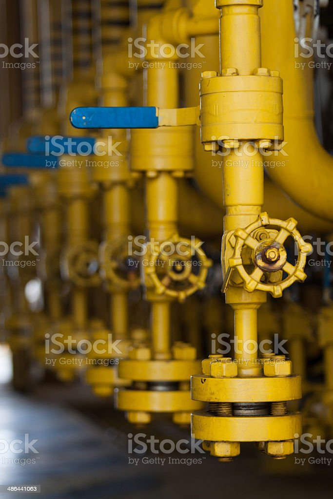 Valves manual in the process royalty-free stock photo