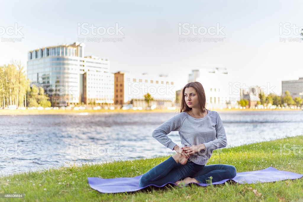 Vamadevasana on riverbank stock photo