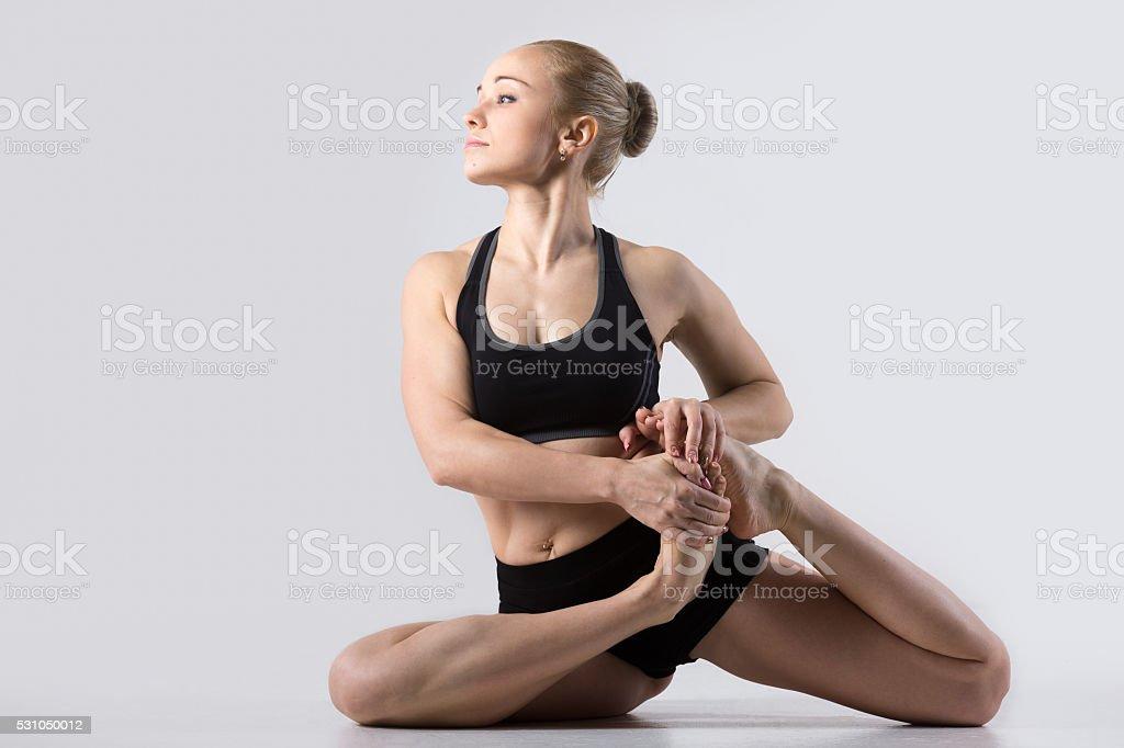 Vamadevasana yoga pose stock photo