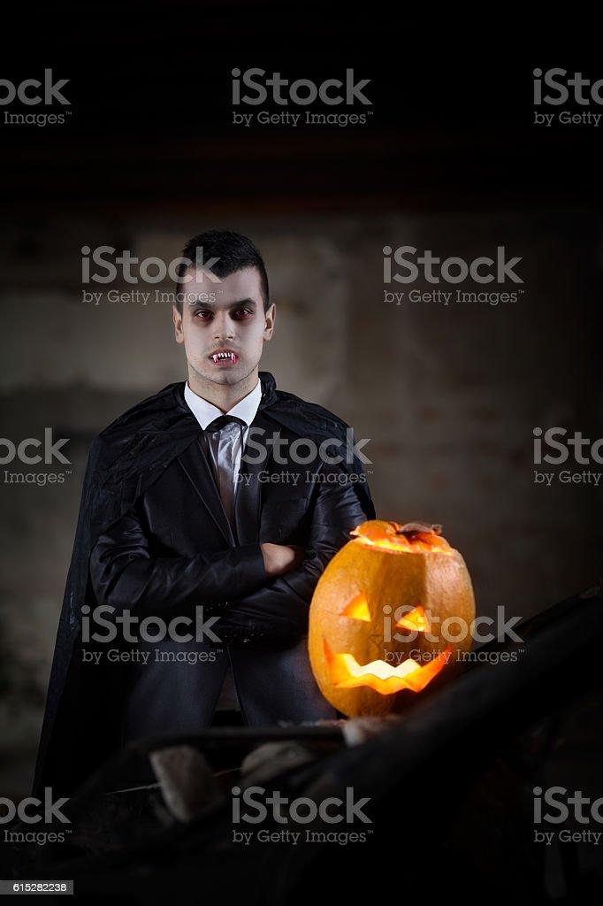 Vampire and Jack O' Lantern stock photo