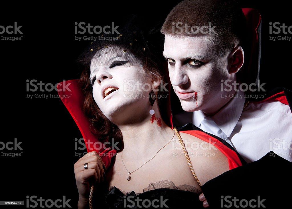 vampire couple bite royalty-free stock photo