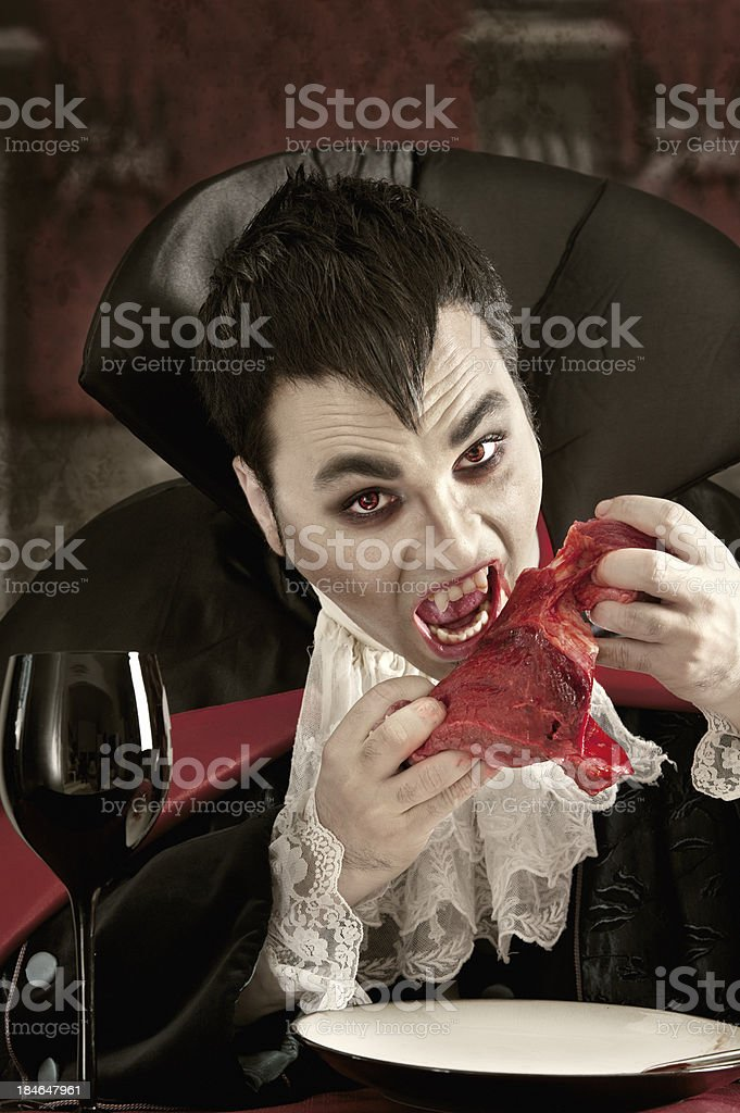 Vampire eating meat stock photo
