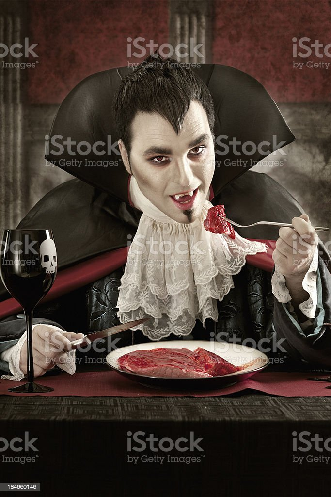 Vampire eating meat royalty-free stock photo