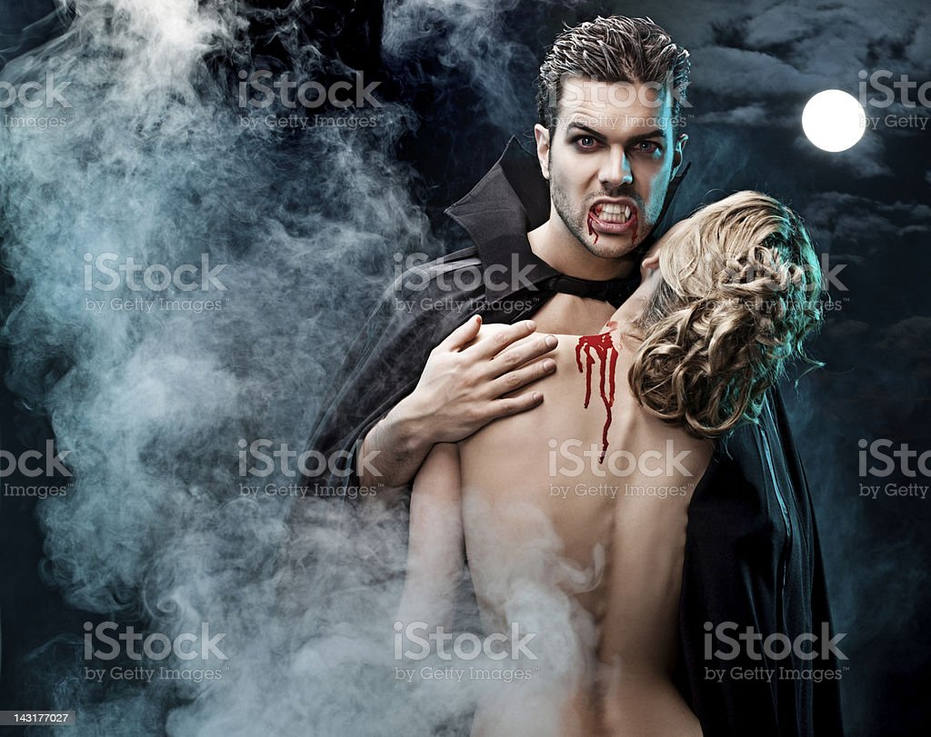 vampire holding his victim royalty-free stock photo