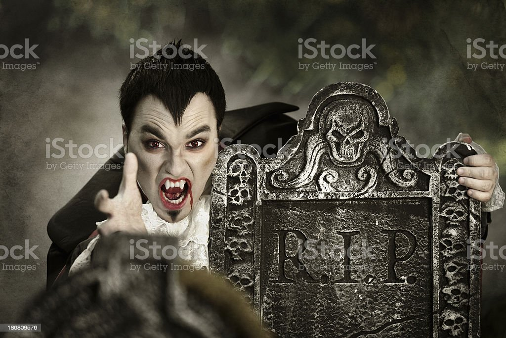 Vampire in a cemetery royalty-free stock photo