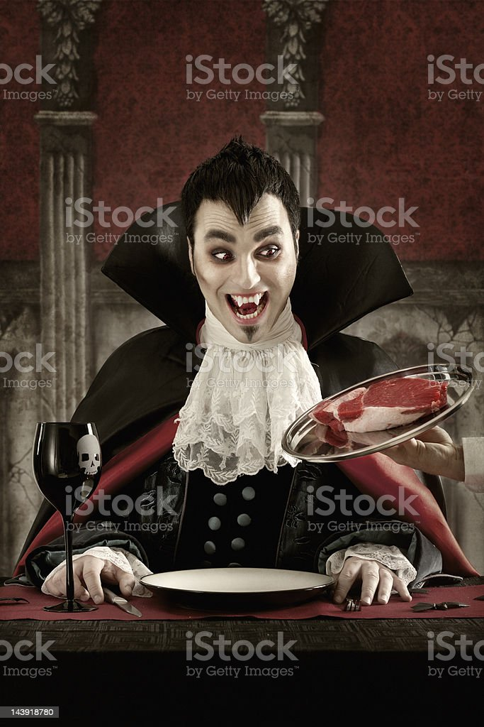 Vampire ordering meat stock photo