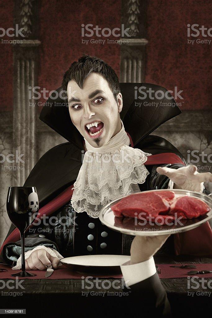Vampire ordering meat stock photo