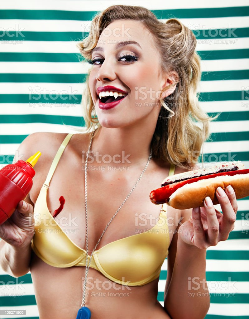 Vampire pin up with bloody hot dogs stock photo