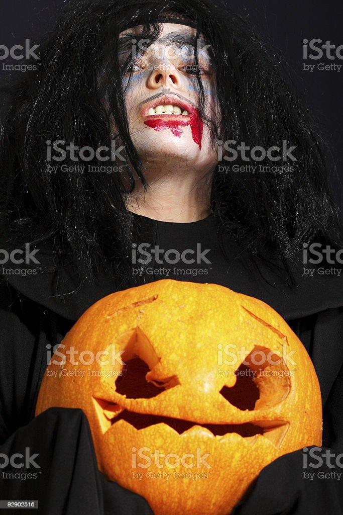 Vampire with pumpkin stock photo