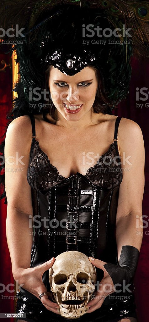 Vampire Woman and Skull stock photo