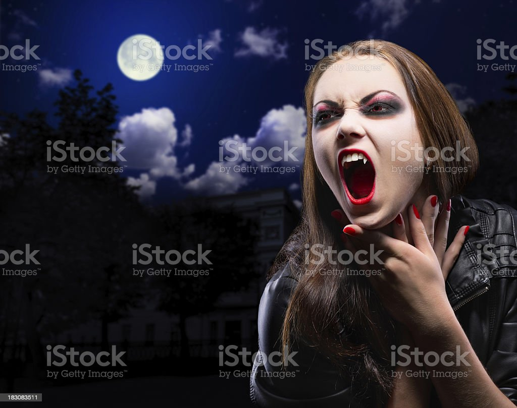 Vampire woman on night background royalty-free stock photo