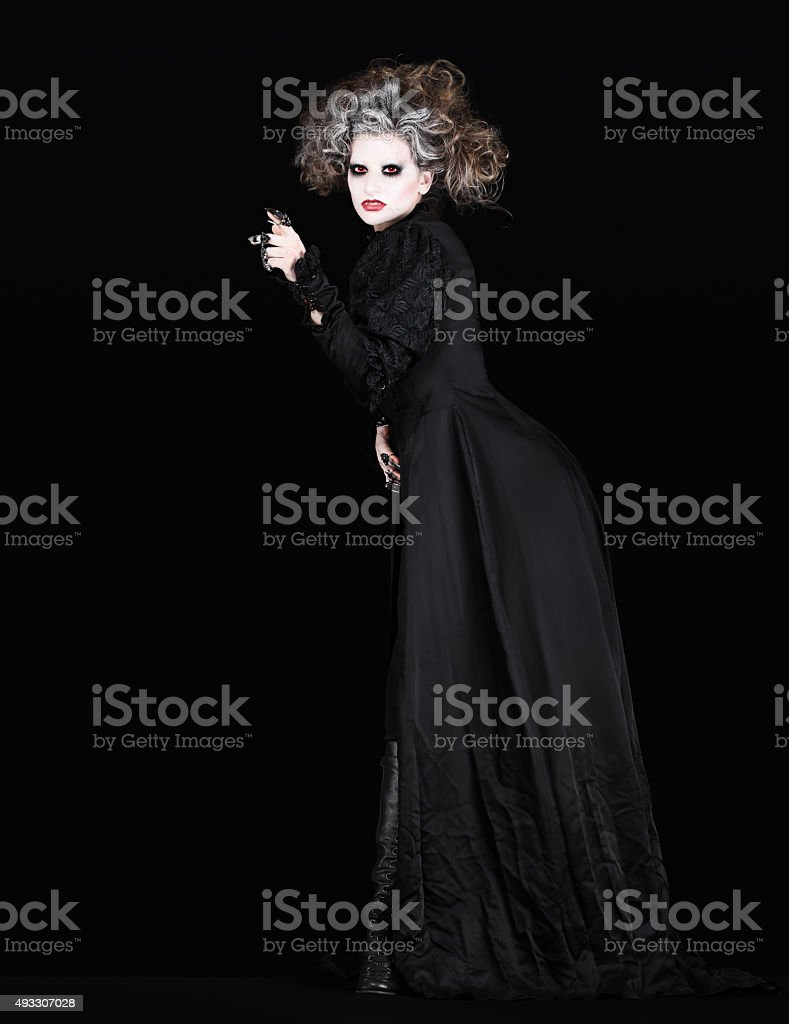 vampire woman with black gothic costume halloween concept stock photo