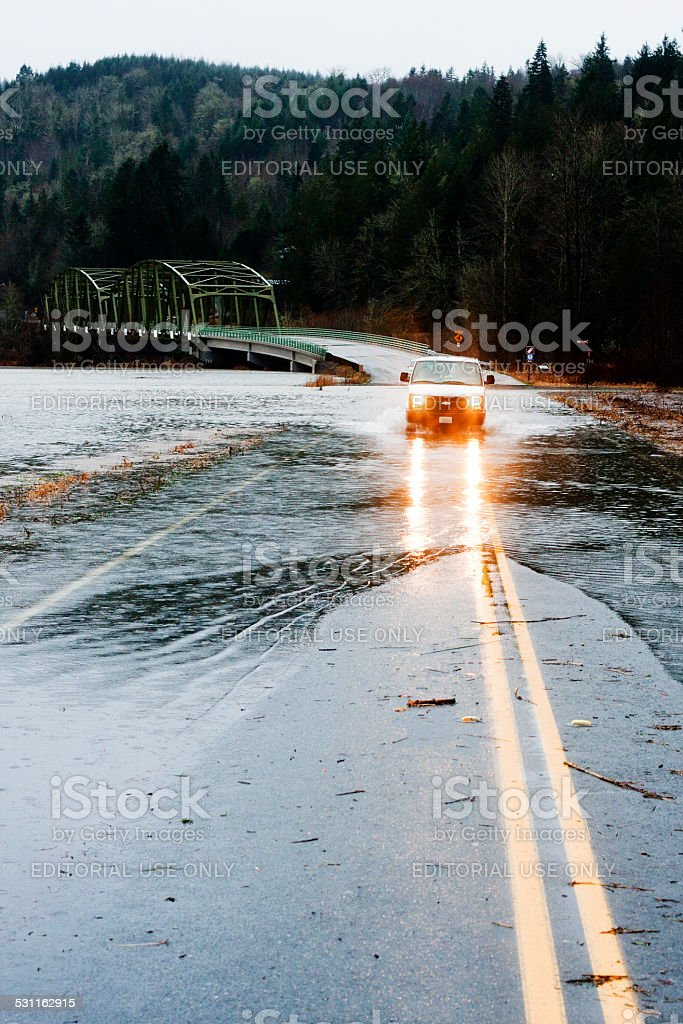 Van Crossing on Flooded Tolt Hill Road stock photo