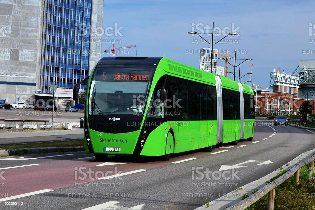 Van Hool Exqui.City tram-bus on the road stock photo