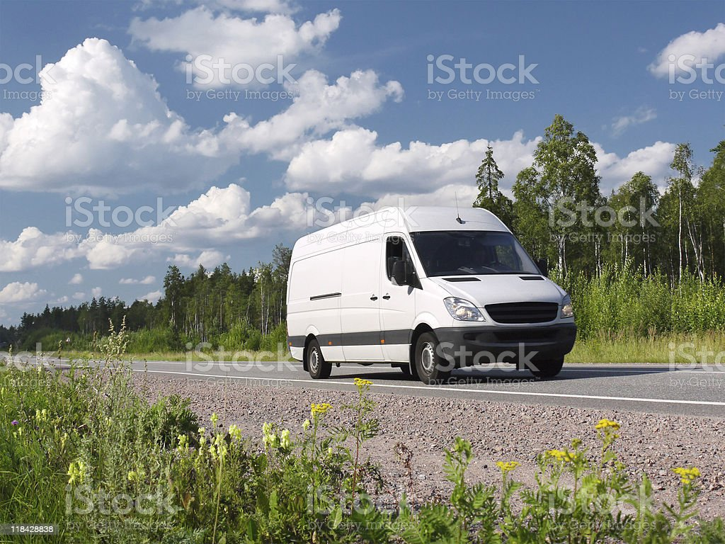 van on country highway stock photo