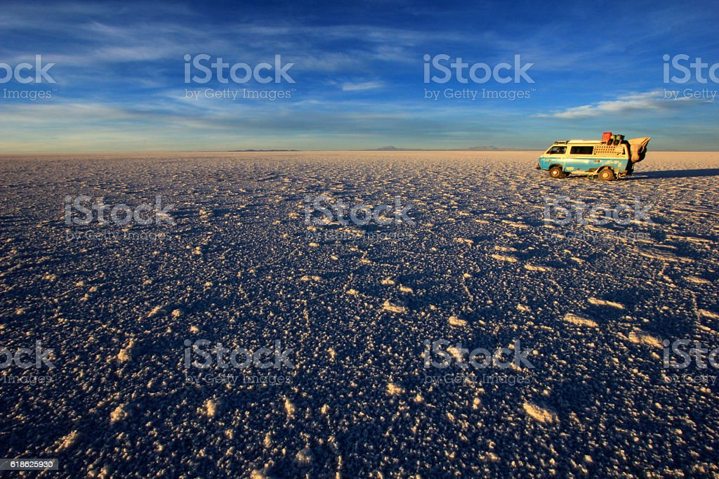 Van on Salar de Uyuni, salt lake, Bolivia stock photo