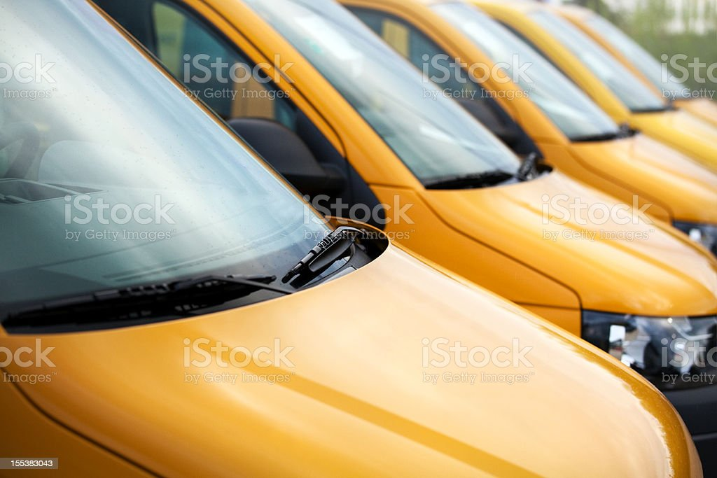 Van vehicles in a row stock photo