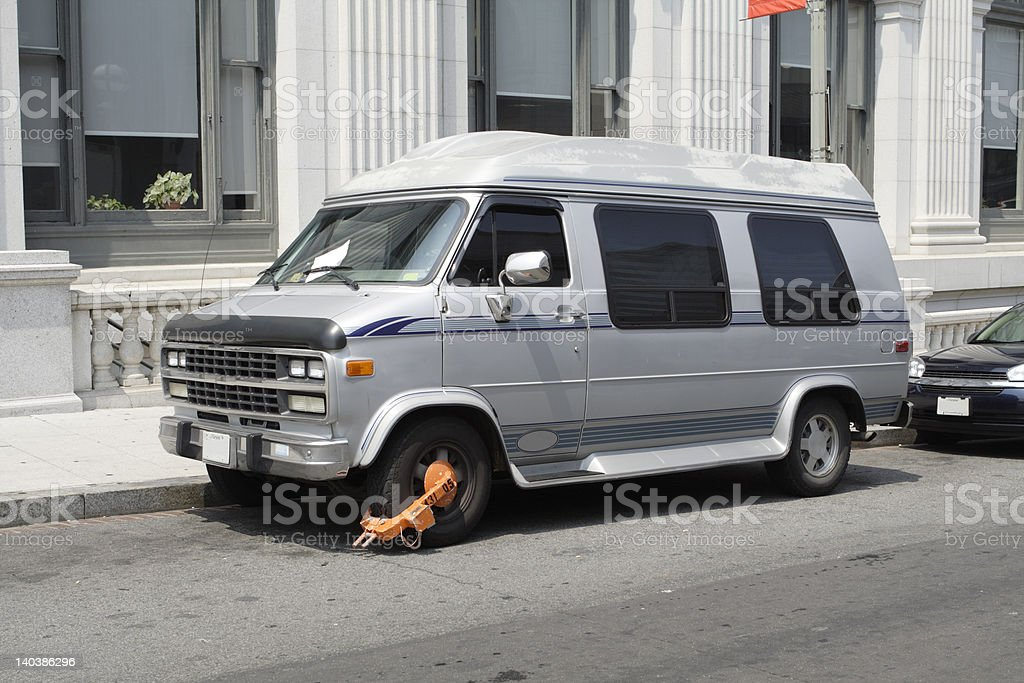 Van with parking ticket and boot, so can't be driven stock photo
