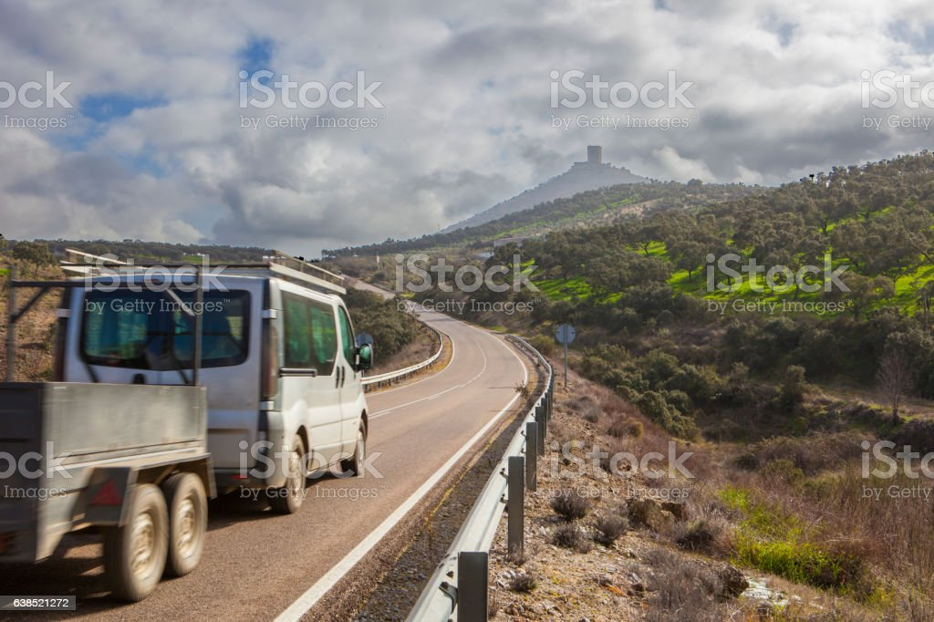 Van with trailer moving towards Feria Castle Hill stock photo
