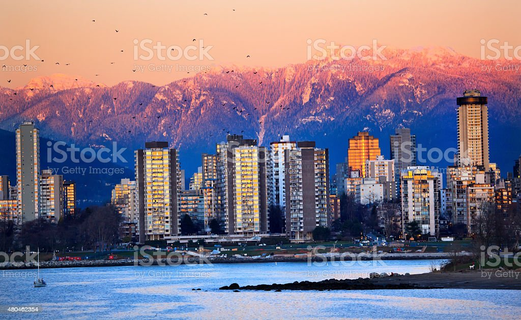 Vancouver Skyline Harbor English Bay Birds Snow Mountains Sunset stock photo