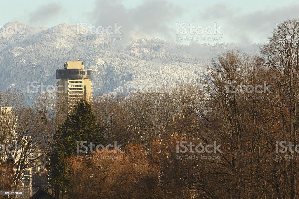 Vancouver Tower, Snow on Coast Mountains royalty-free stock photo