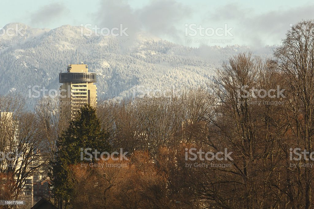 Vancouver Tower, Snow on Coast Mountains stock photo