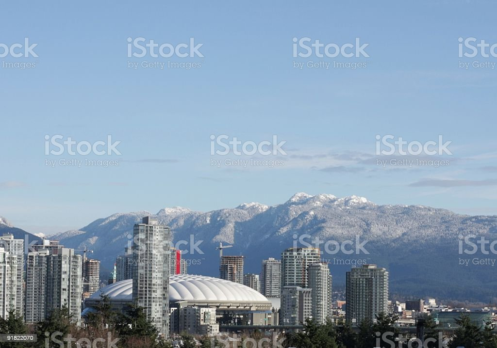 Vancouver's North Shore Mountains and BC Place Stadium in Winter royalty-free stock photo