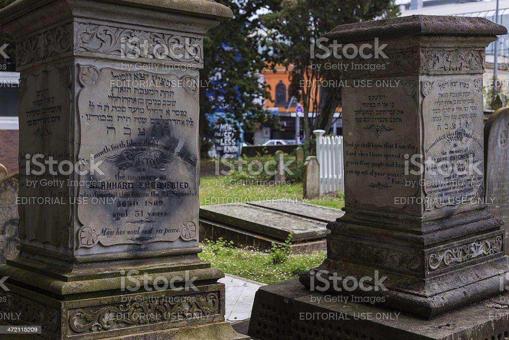 Vandalised tomb stones stock photo