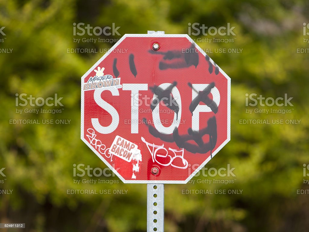 Vandalism on a Stop Sign stock photo