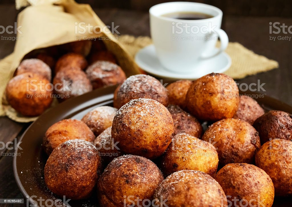 Vanilla cheese balls, deep fried and a cup of tea. stock photo
