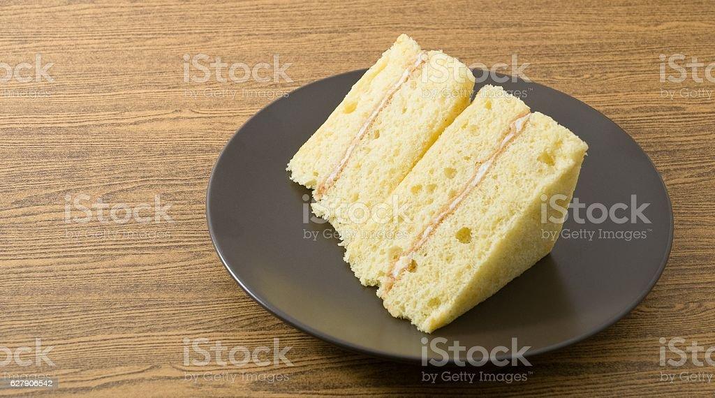 Vanilla Chiffon Cake on A Black Dish stock photo