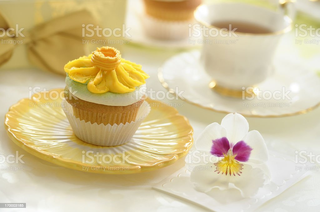 Vanilla Cupcake decorated with buttercream icing yellow daisy flower icing stock photo