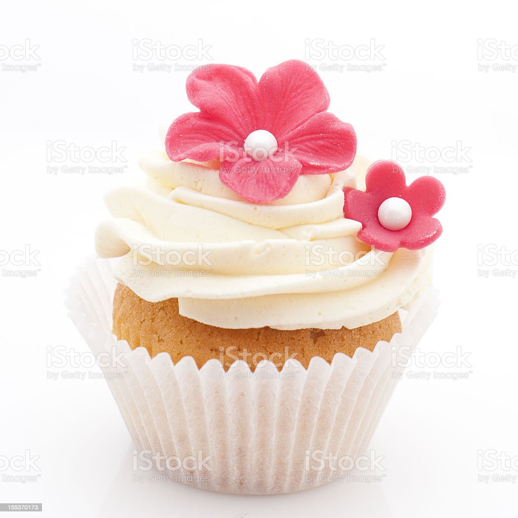 Vanilla cupcake with red sugar flowers stock photo