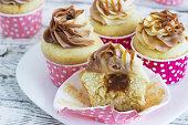 Vanilla cupcakes with a cap of cream