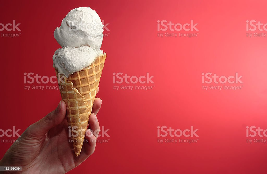 Vanilla Ice Cream Cone on Red with Space for Copy royalty-free stock photo