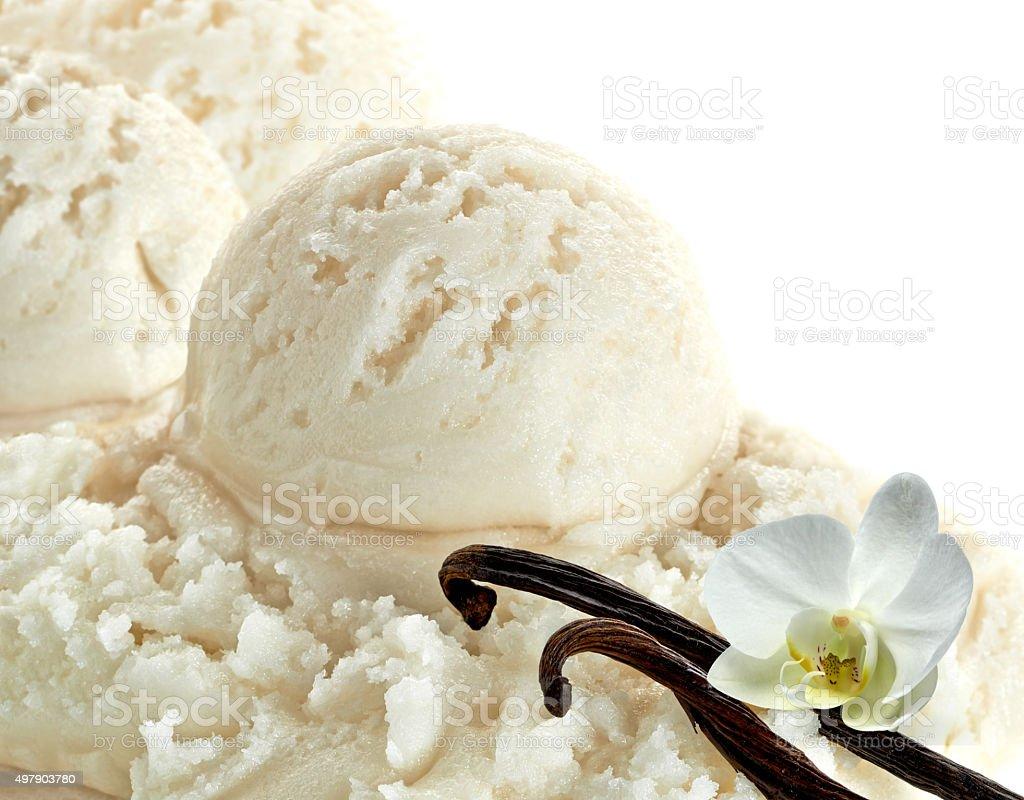 Vanilla ice cream scoops with vanilla beans stock photo