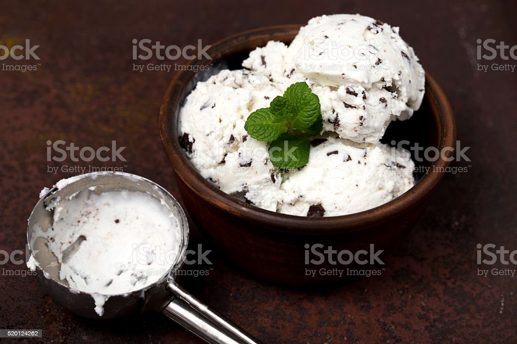 vanilla ice cream with chocolate chips - straciatella stock photo