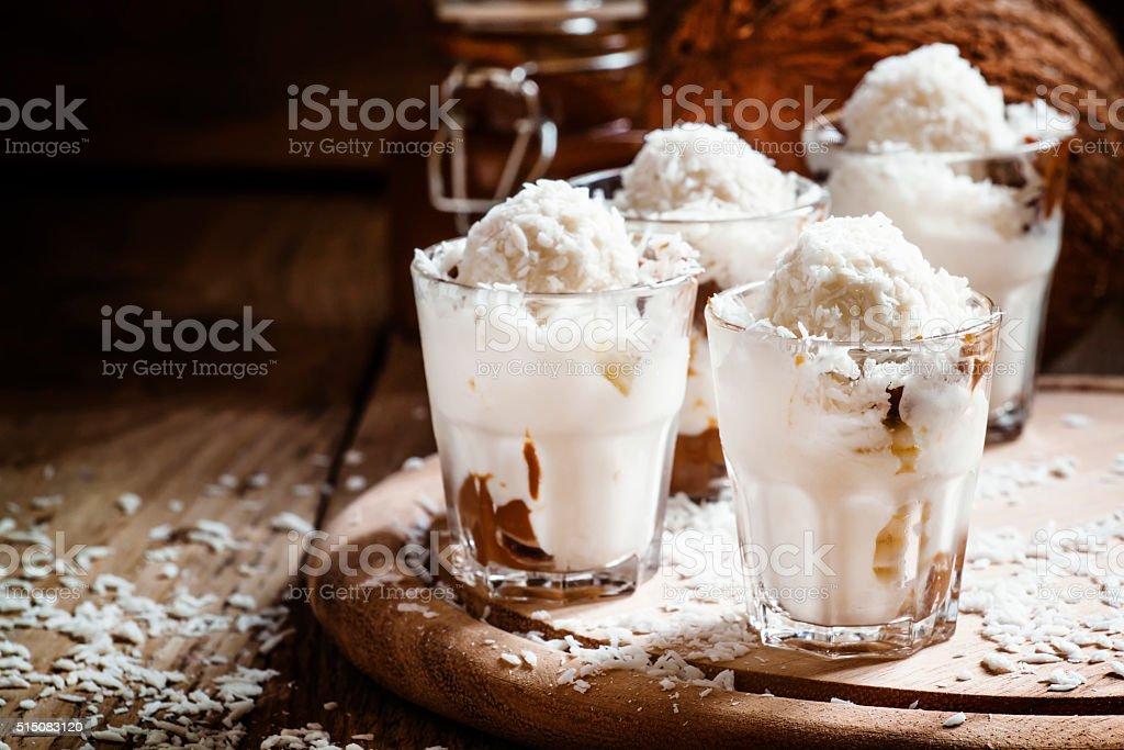 Vanilla ice cream with coconut and caramel sauce stock photo