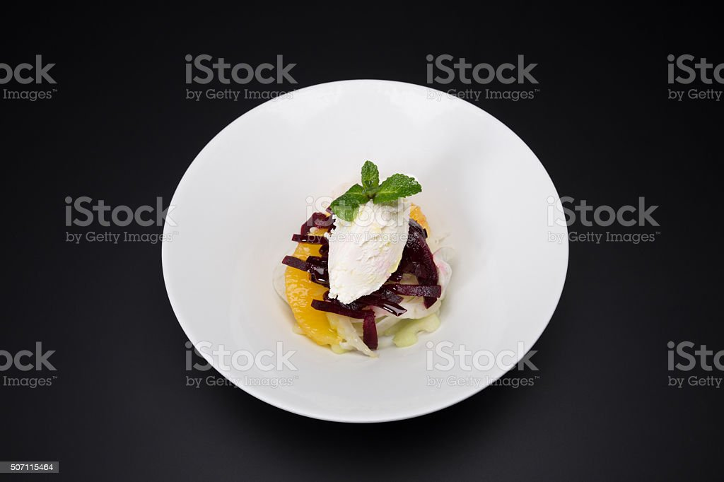 Vanilla ice cream with fruit (black background) stock photo