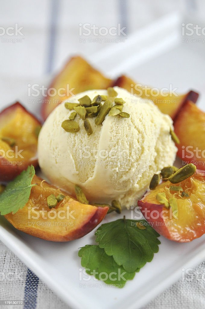Vanilla Ice Cream with Peach and pistachio royalty-free stock photo