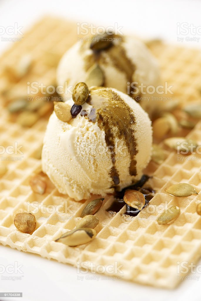 Vanilla ice-cream on a wafer with pumpkin seeds royalty-free stock photo