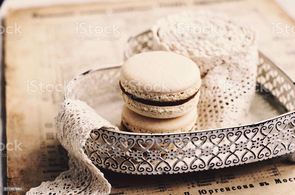 Vanilla macaroon with caramel filling, retro style stock photo