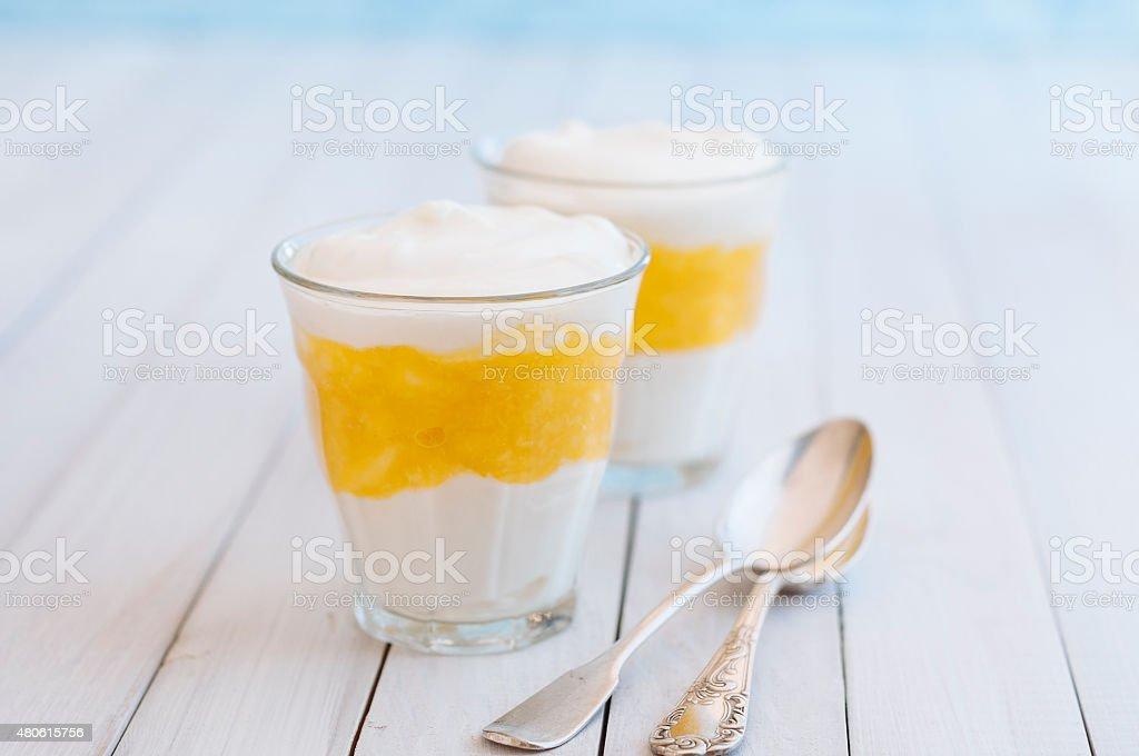 Vanilla Mango Dessert with two spoons stock photo