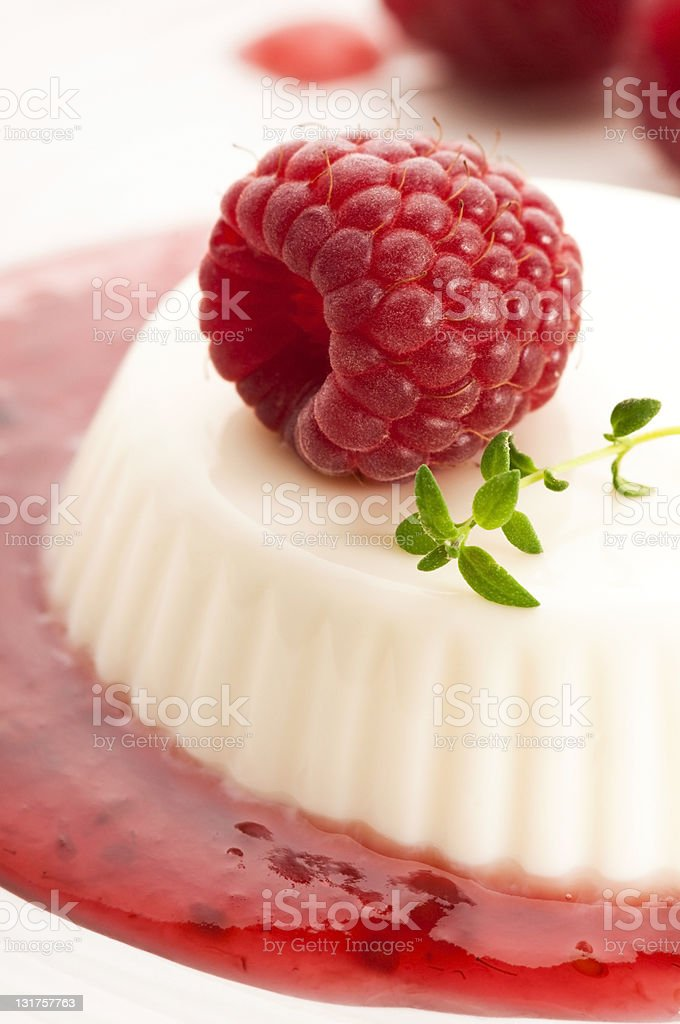 Vanilla panna cotta with berry sauce royalty-free stock photo
