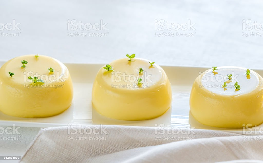 Vanilla puddings decorated with fresh mint stock photo