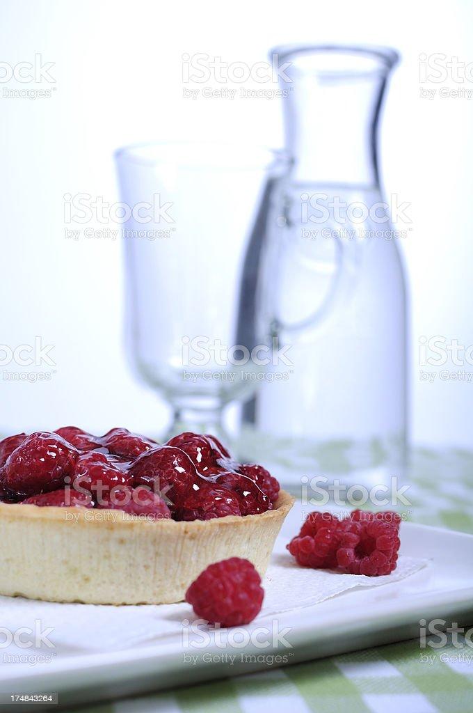 Vanilla tart with fresh raspberries royalty-free stock photo