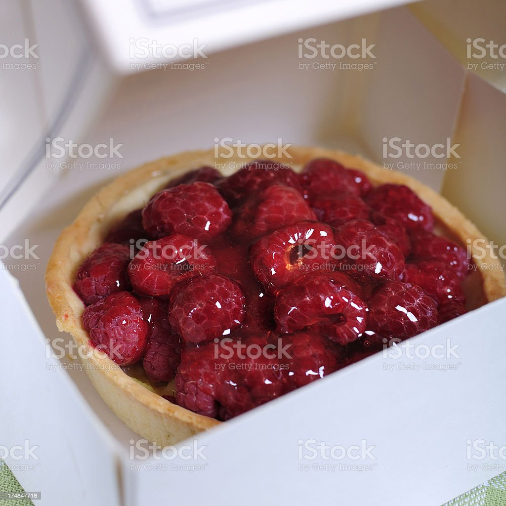 Vanilla tart with fresh raspberries stock photo