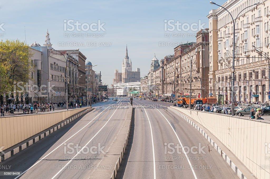 Vanishing empty street with people on roadside stock photo
